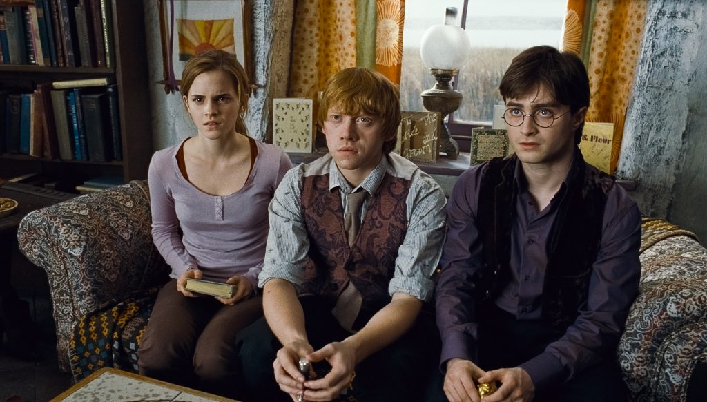 HP7-1-FP-00167 (L-r) EMMA WATSON as Hermione Granger, RUPERT GRINT as Ron Weasley and DANIEL RADCLIFFE as Harry Potter in Warner Bros. PicturesÕ fantasy adventure ÒHARRY POTTER AND THE DEATHLY HALLOWS Ð PART 1,Ó a Warner Bros. Pictures release. Photo courtesy of Warner Bros. Pictures